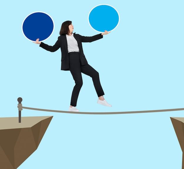 Businesswoman balancing on a rope Premium Psd