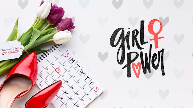Calendar beside tulips bouquet Free Psd