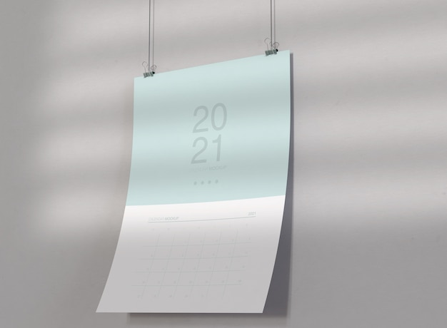 Calendar mockup hanging on wall Free Psd