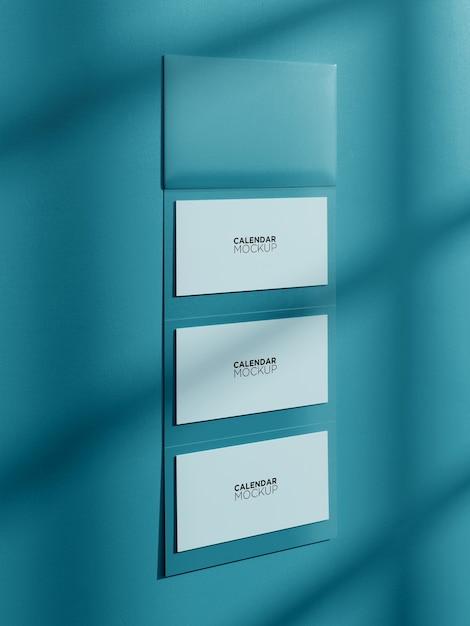 Макет календаря изолированный висит на стене Premium Psd
