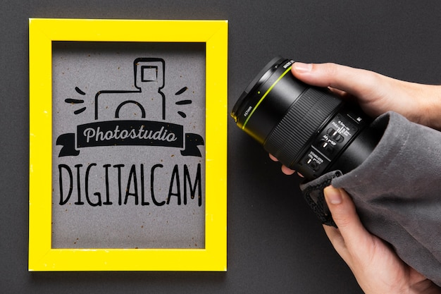 Camera beside frame with studio logo Free Psd