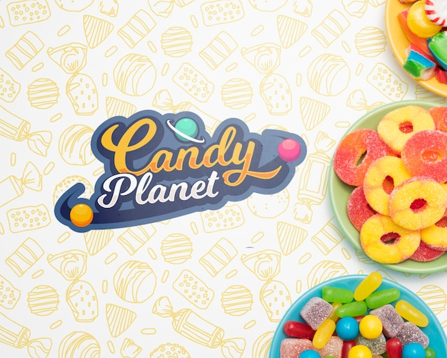 Candy planet and plates filled with candies Free Psd