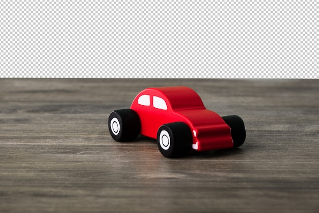 Car toy on a wooden surface Premium Psd