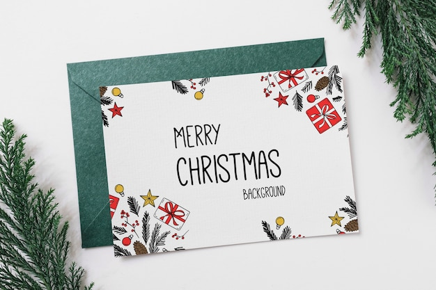Card and envelope mockup with christmas concept Free Psd