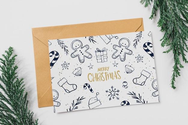 Макет карты и конверта с концепцией рождества Бесплатные Psd