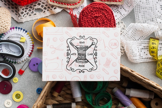 Card mock-up with sewing tools Free Psd