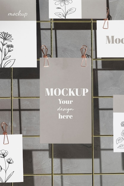 Cards hanging on grid wire board with clips Premium Psd