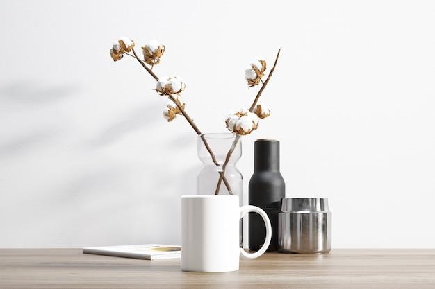 Ceramic mug and cotton plant inside flowerpot Free Psd
