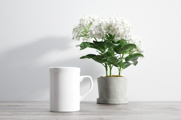Ceramic mug and flower inside flowerpot Free Psd