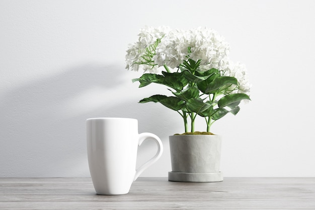 Ceramic mug and flower inside flowerpot Free Psd