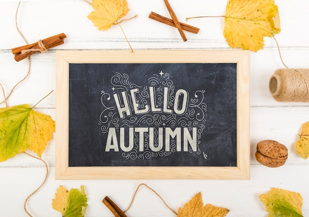 Chalk board with hello message for autumn Free Psd