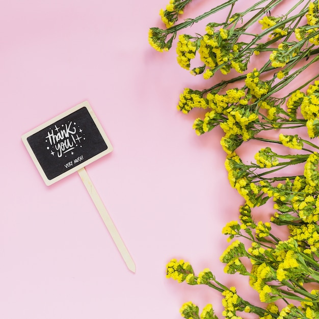 Chalkboard mockup with floral decoration Free Psd