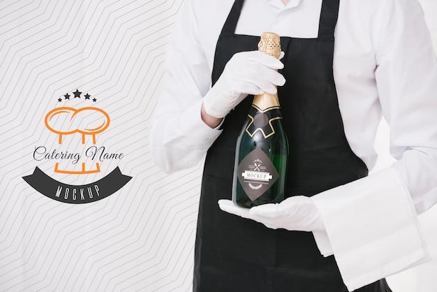Champagne accanto al segnaposto del nome del catering Psd Gratuite