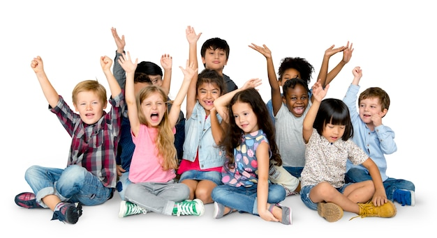 Cheerful children having a great time together with their hands raised Premium Psd