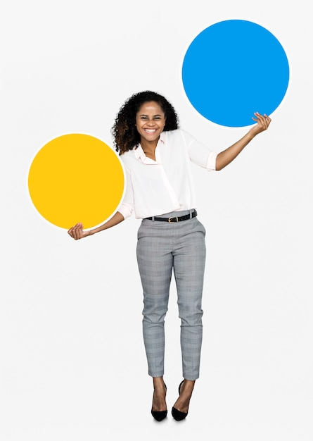Cheerful woman holding colorful round boards Free Psd