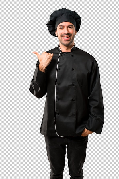Chef man In black uniform pointing to the side with a finger to present a product Premium Psd
