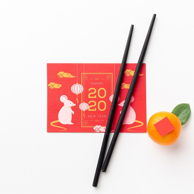 Chinese new year concept with  chopsticks Free Psd