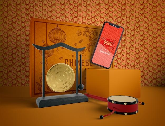 Китайский новый год иллюстрация с телефоном макете Бесплатные Psd