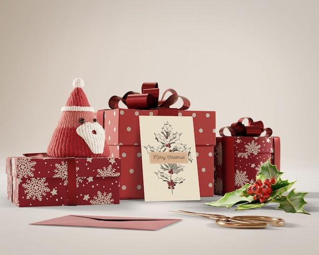 Christmas card and gifts on table Free Psd