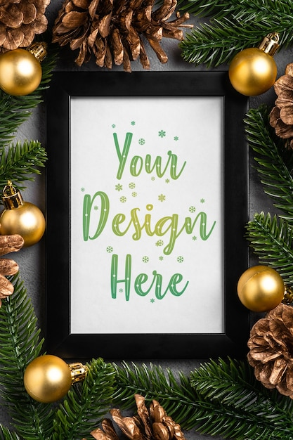 Christmas composition with empty picture frame. golden ornament, pine cones and fir needles decorations. mock up greetings card template Premium Psd