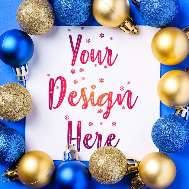 Christmas composition with white square copy space. colorful ornament and baubles decorations. mockup greetings card template Premium Psd