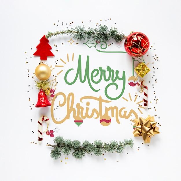 Christmas elements surrounding merry christmas concept Premium Psd