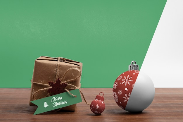 Christmas gift box and globes Free Psd