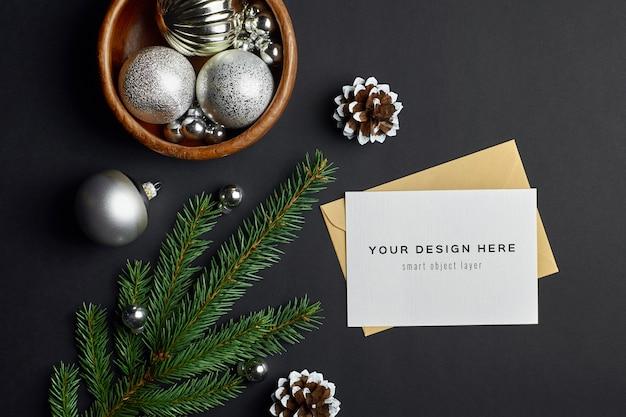전나무 나무 가지와 어둠에 축제 장식 크리스마스 인사말 카드 모형 프리미엄 PSD 파일