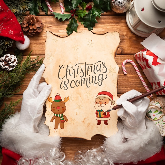 Christmas letter mock-up held by santa Free Psd