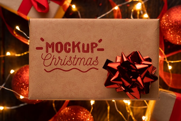 Christmas mock-up gift with red bow Premium Psd