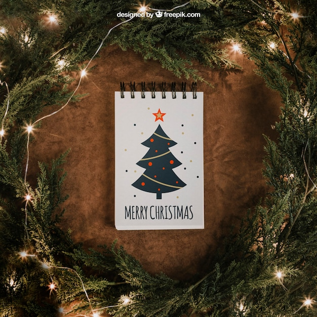 String Lights Psd : Christmas mockup with notepad and string lights PSD file Free Download