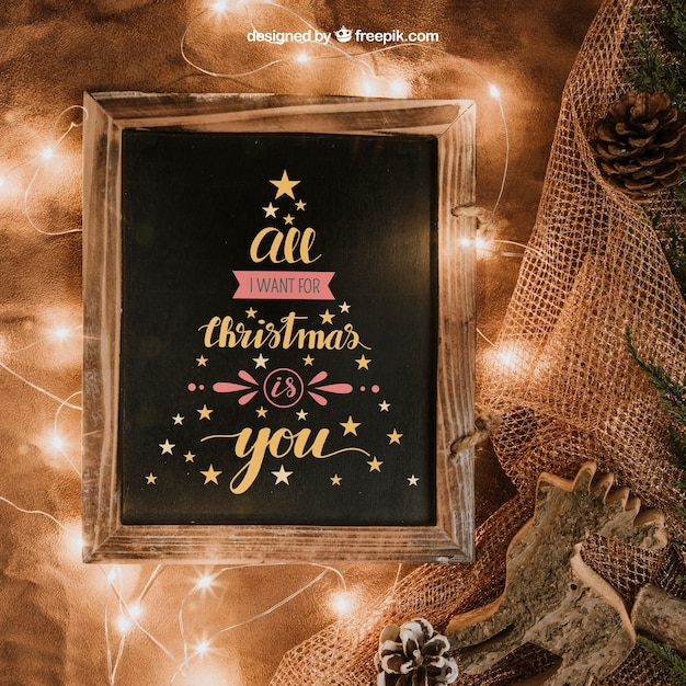 Christmas mockup with slate and lights Free Psd