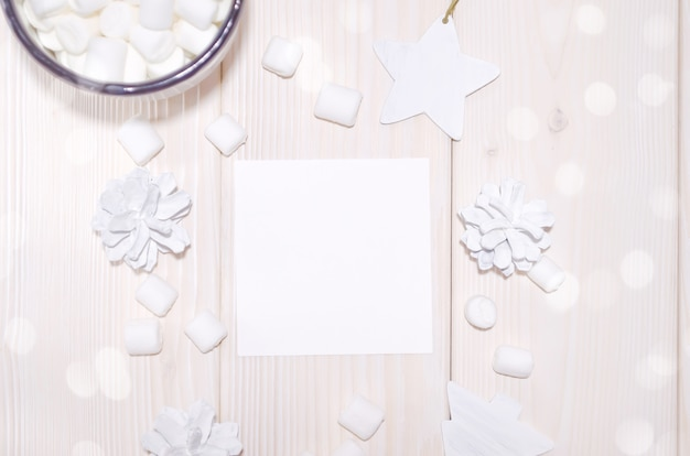 Christmas square card mockup with white decorations on white wood table Premium Psd