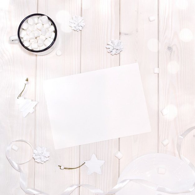 Christmas with card mockup and white decorations on  wood table Premium Psd