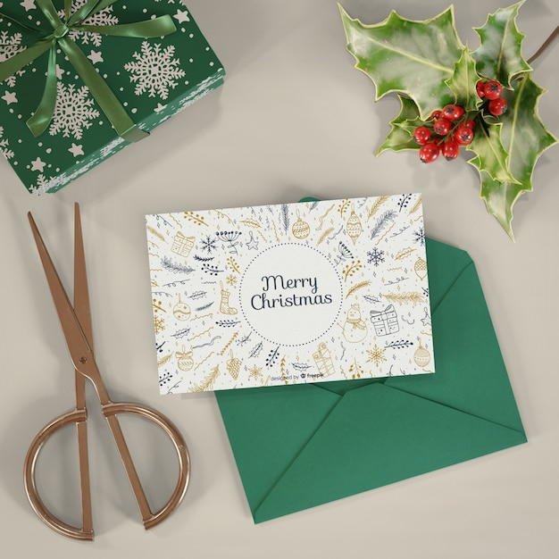 Chrsitmas card and present mock-up Free Psd