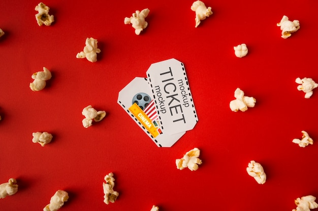 Cinema tickets surrounded by popcorn Free Psd
