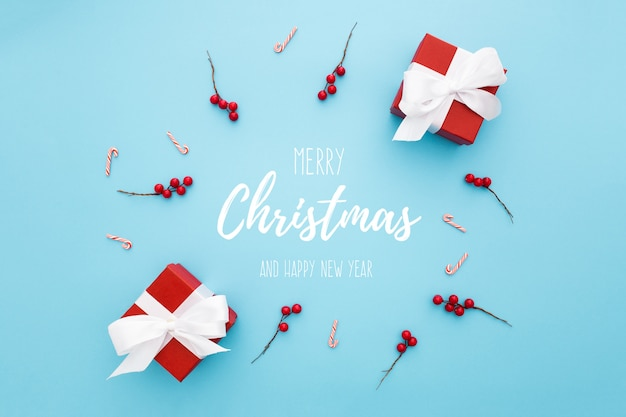 Circular composition with christmas ornaments on a blue background Free Psd