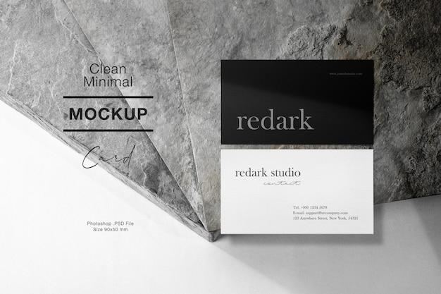 Чистый минимальный макет визитной карточки на серый камень и светлая тень. Premium Psd