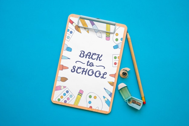 Clipboard mockup with back to school concept Free Psd