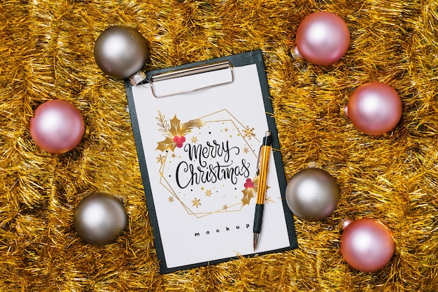 Clipboard mockup with christmas decoration Free Psd