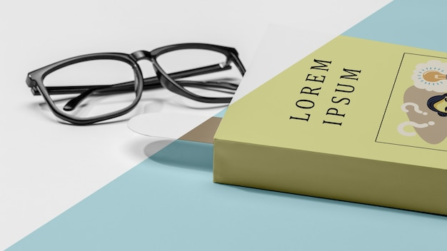Close-up book mock-up with glasses Free Psd