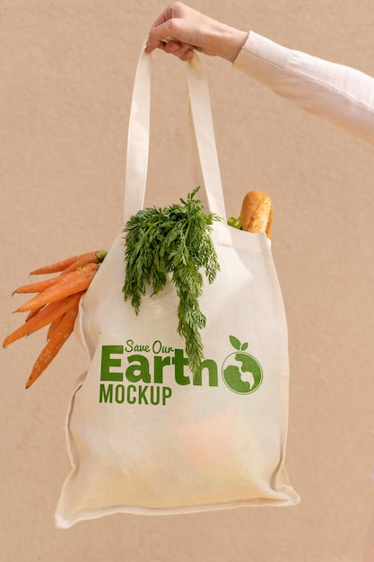 Close-up hand holding bag with vegetables Free Psd