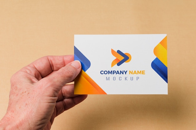 Close-up hand holding business card mock-up Free Psd