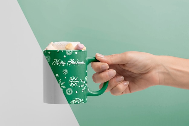 Close-up hand holding mug Free Psd