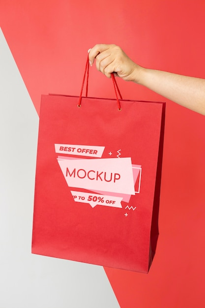Close-up hand holding shopping bag Free Psd