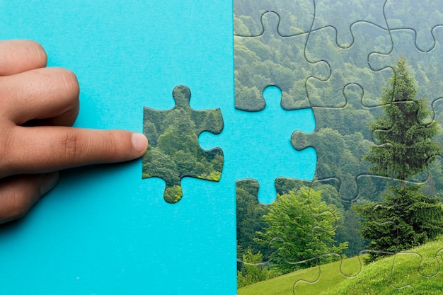 Close-up man making a puzzle Free Psd