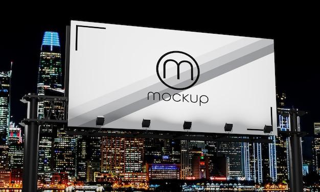 看板モックアップデザインの夜の街の明かりにクローズアップ Premium Psd