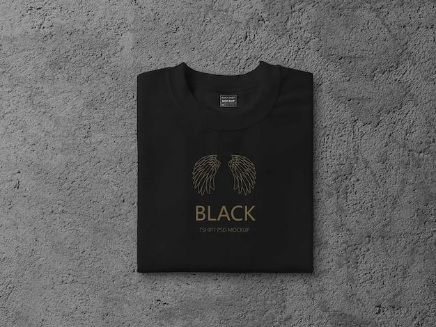검은 접힌 T 셔츠 모형에 가까이 프리미엄 PSD 파일