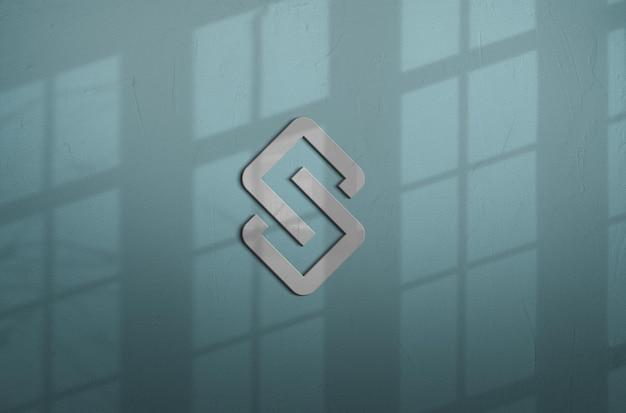 벽에 로고 모형 디자인에 가까이 프리미엄 PSD 파일