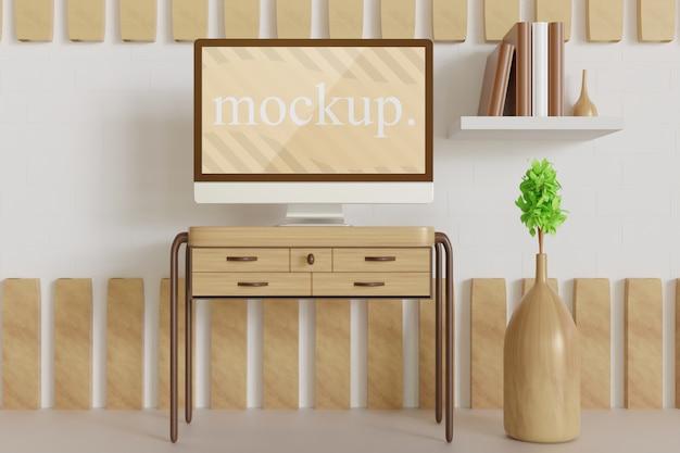 木製のテーブルのモニターのモックアップ、植物の花瓶の正面図をクローズアップ Premium Psd